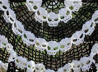 Wikked Skulls Half Moon Shawl, crochet pattern by Spider Mambo for sale on Ravelry