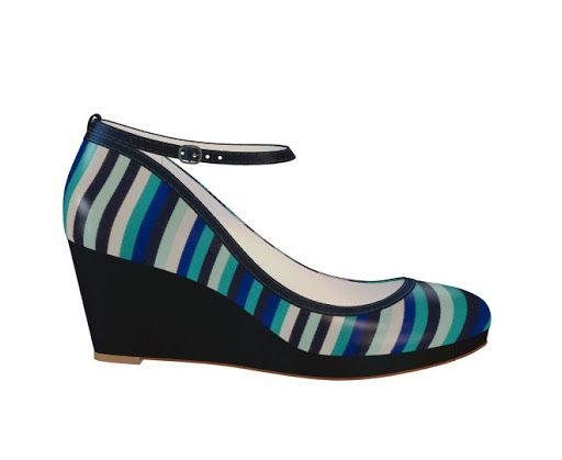 Various shades of blue striped wedge heel with ankle strap. Again the strap to help keep the shoe on, as this shape would be quite prone to the shoe slipping off.