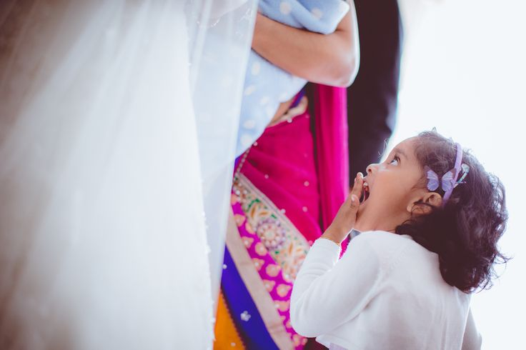 #bridemaid staring at #bride looking surprised #indian#wedding #girl #flowergirl #surprise #amazed #cute #tradition