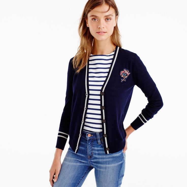 A classic tipped cardigan with a cool collegiate-inspired twist: a sparkly…