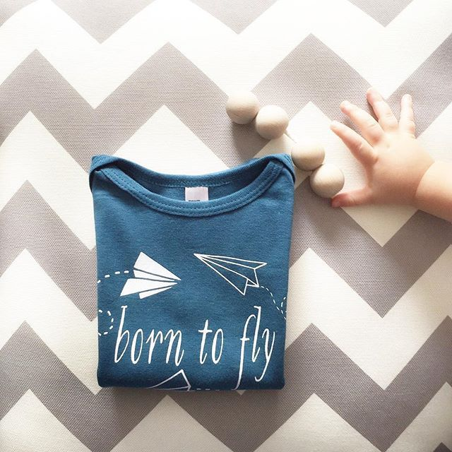 For little cutees who want to fly. An organic baby onesie and childrens' t-shirt inspired by paper airplanes.