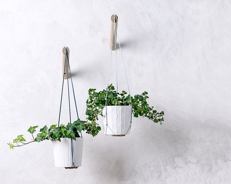 Hanging planter with light blue thread wall by loopdesignstudio