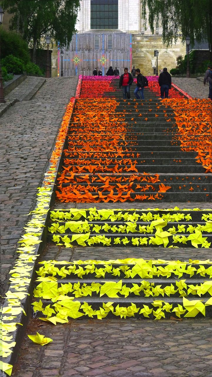 French artist Mademoiselle Maurice brightened up  the city of Angers, France by using origami to decorate staircases, walkways, schools, leisure centers, the side of buildings, and even a prison.