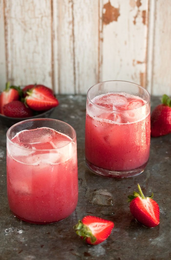 a delectable cocktail with strawberries and coconut water | Drizzle and Dip