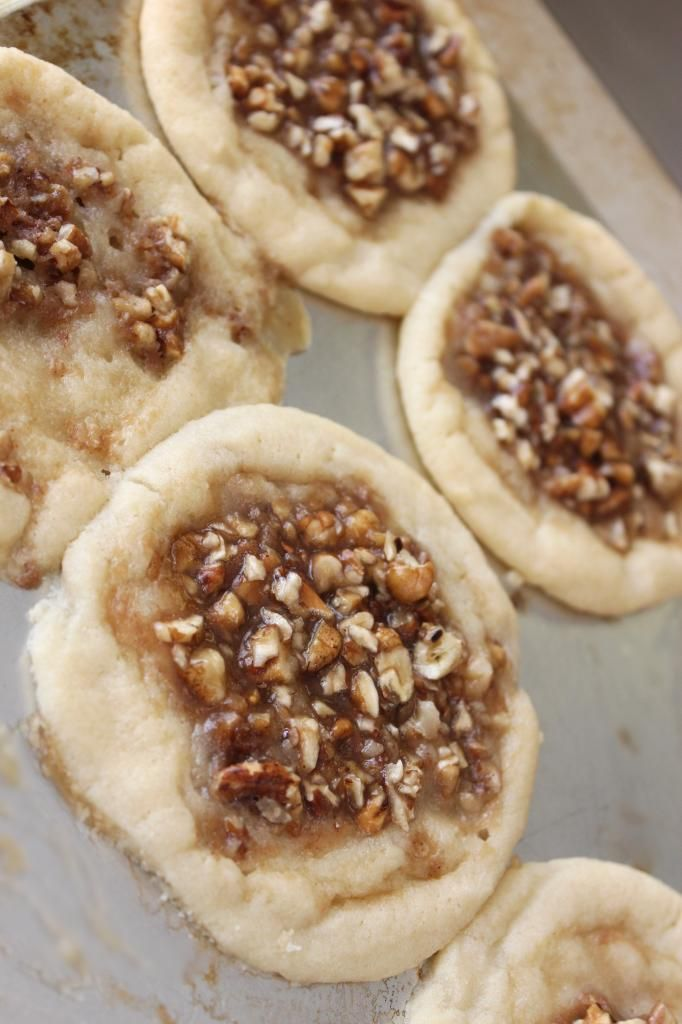 1 tube refrigerated Pillsbury sugar cookie dough 1 cup chopped pecans½ cup light brown sugar, firmly packed1/4 cup heavy whipping cream (I substituted 1/3 cup milk)1 tsp. vanillapinch each of ginger, cinnamon, and/or cloves – optional* (I used cinnamon)