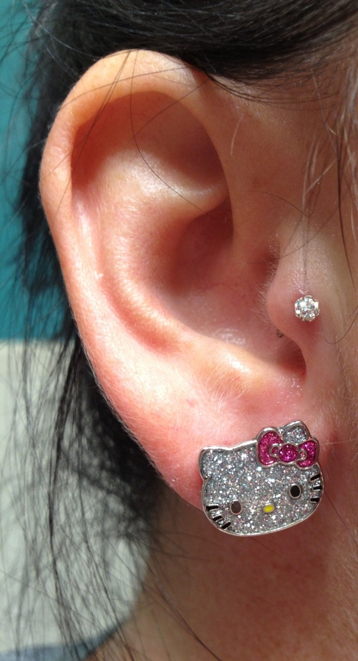 New tragus piercing :) didn't hurt like I thought.. Just felt like a lot of pressure really.. NO PAIN AT ALL :)