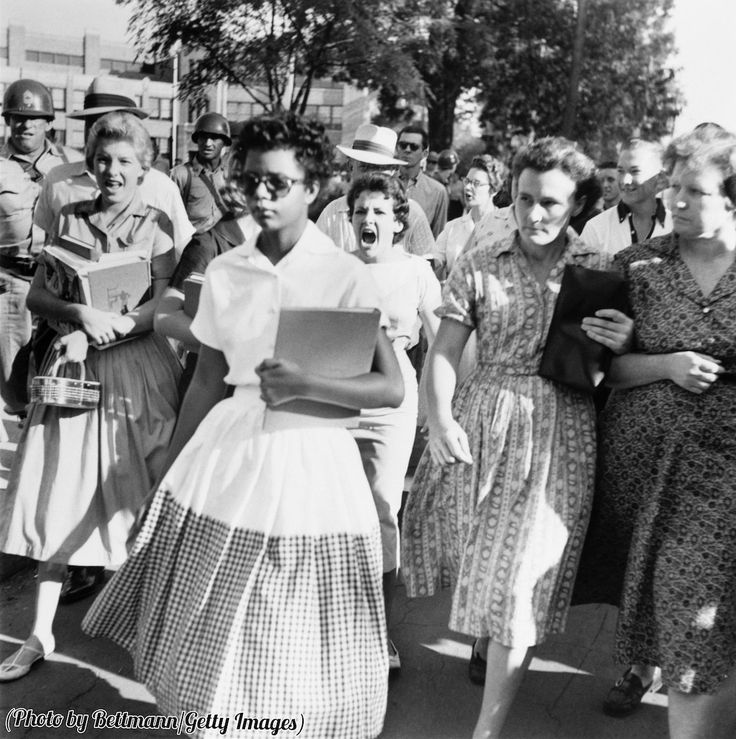 Elizabeth Eckford ignores the screams of students on her first day integrated into a Little Rock High School, 1957.