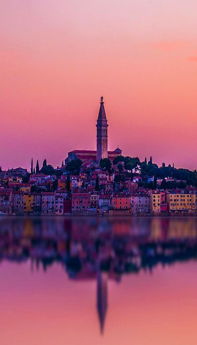 The Rovinj City in Croatia. Located on the western coast of the Istrian peninsula, it 's a popular tourist resort and an active fishing port. Istriot, a Romance language once widely spoken in this part of Istria, is still spoken by some of the residents.
