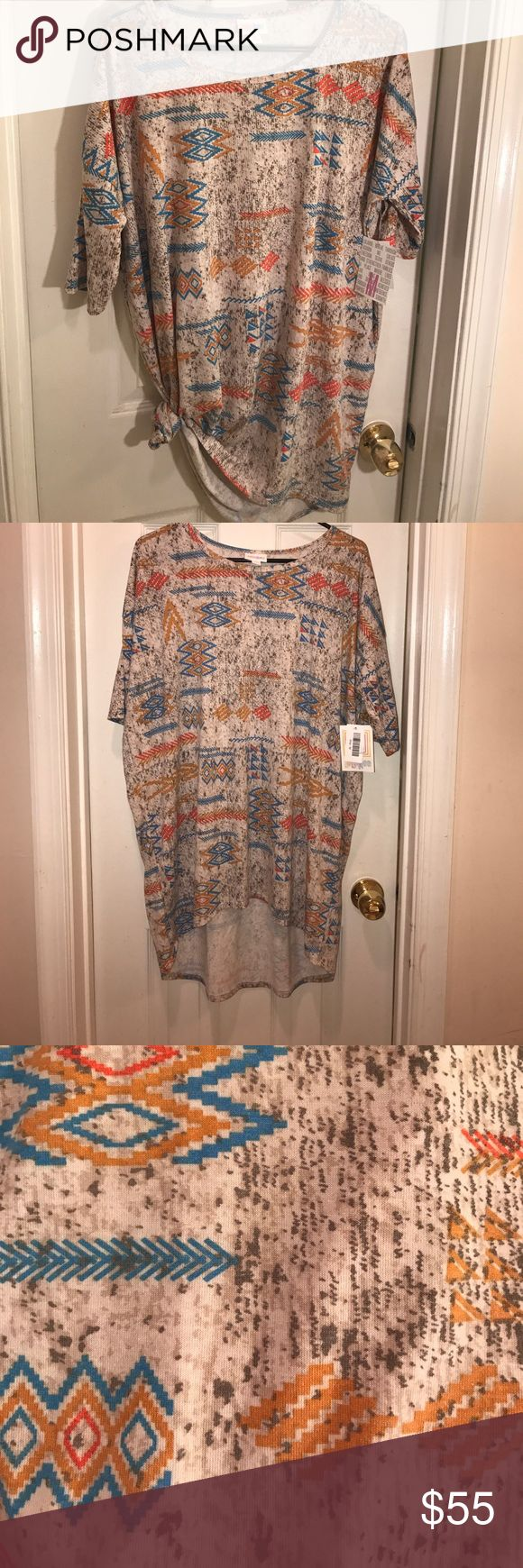 🦄 Alert! LuLaRoe HTF Aztec Print Irma Tunic The Irma tunic is SUPER comfortable, chic and highly versatile. Can be worn as a casual tunic over leggings w/ boots or tied at the hip with jeans, pulled off the shoulder or over a tank top. Med fits sizes 8-14. The high/low cut and dolman sleeve that goes to the elbow is incredibly stylish (and my arms appreciate the coverage). This print tho? Crazy cool and impossible to find. Bright blue, mustard & coral over muted cream and gray. Chevrons…