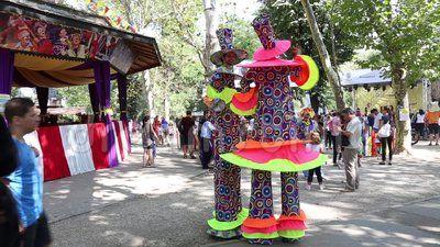 Clowns on stilts in the park Cismigiu, Bucharest, Romania.