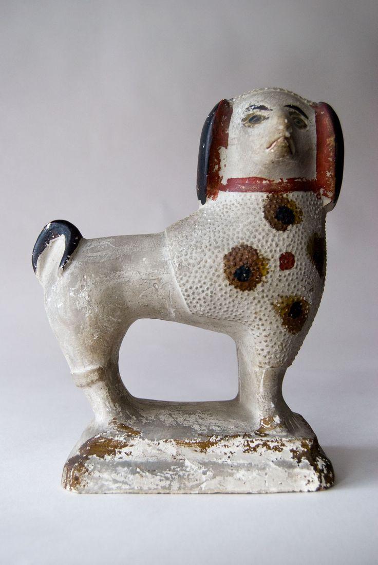 chalkware poodle modeled after Staffordshire dog