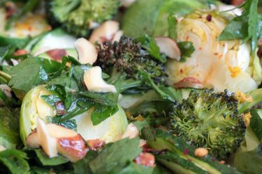 Roasted greens with lemony dressing and hazelnuts