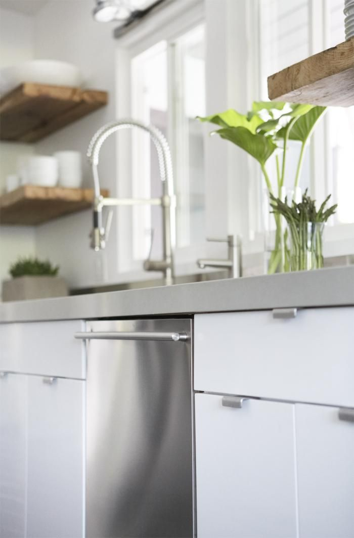 Caesarstone counters in Cinder (look like concrete) and natural salvaged wood for open shelves.