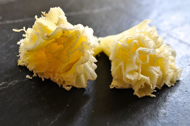 wispy curls of cheese tête de moine : delicate and tasty