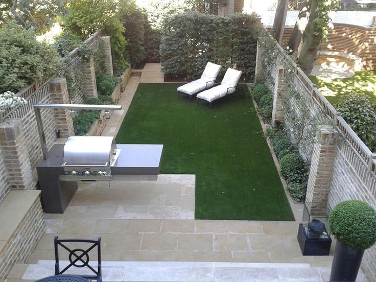 London garden with barbecue and concealed storage area by Jo Thompson Garden Design