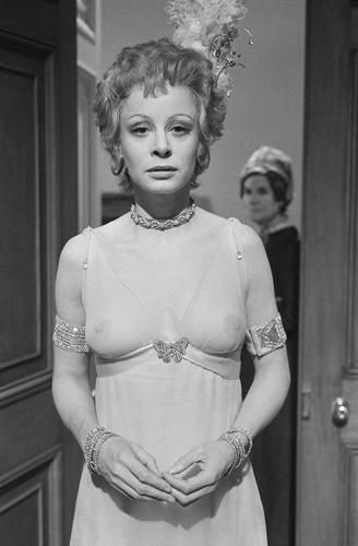 """Sarah Miles See-Through Dress 2 photo by Terry O'Neill   Sarah Miles dressed in a see-through costume and wearing a feather in her hair for the drama 'Lady Caroline Lamb' directed by Robert Bolt in England, 1972.  Limited Edition Silver Gelatin Signed and Numbered  12"""" x 16"""" / 16"""" x 20""""  20"""" x 24"""" / 20"""" x 30""""  24"""" x 34"""" / 30"""" x 40"""" / 40"""" x 60"""" / 48"""" x 72""""  For questions or prices please contact us at info@igifa.com    IGI FINE ART"""