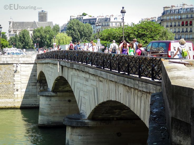 Here's a view taken down one side of Pont de l'Archeveche, showing the small bridge which spans from one side of the River Seine and to the Ile de la Cite island.  You may also like www.eutouring.com/pont_de_l_archeveche.html