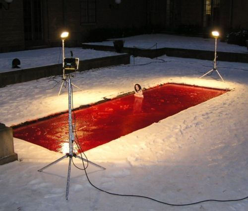 """Dror Feiler """"Snow White and the Madness of Truth"""" / electricity (In 2004, the Israeli ambassador to Sweden, Zvi Mazel, tried to destroy the artwork by unplugging lights and throwing one of them into a pool causing a short circuit.Mazel claimed the work - a long pool of dyed water, upon which floated a small white boat carrying a portrait of a female Palestinian suicide bomber - was antisemitic. Upon entering the gallery space of Stockholm's Museum of National Antiquities, he disconnected the"""