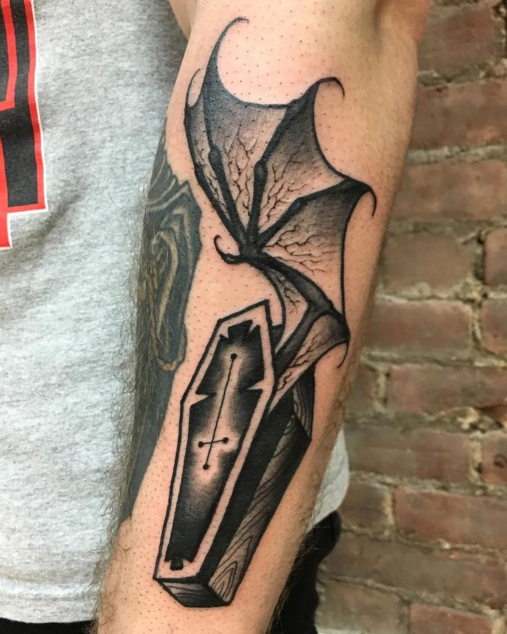 42 Coffin Tattoos With Surprisingly Creative Meanings...Coffin and Bat wing