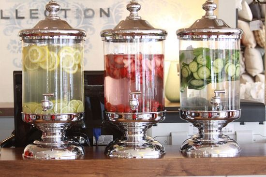 Beautiful display of lemon, strawberry, and cucumber water.  Love this.  Just made strawberry water.  Add sugar to taste and yum! Great Summer drink.