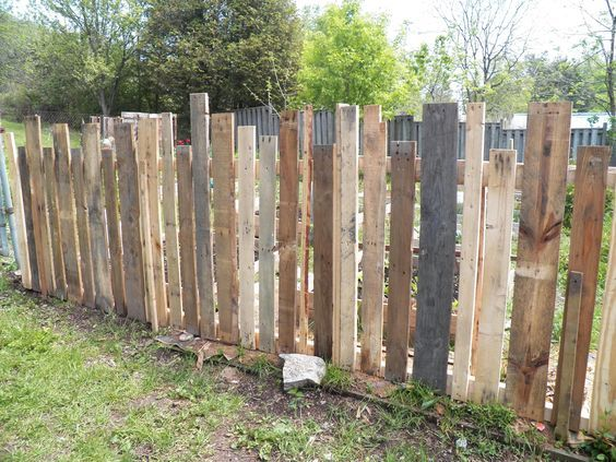 Cute pallet picket fence - it is around our veggie garden and keeps out the dog and hopefully rabbits!