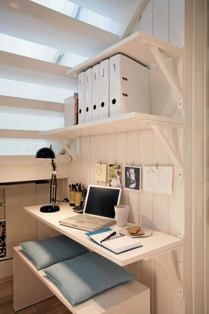 This is a nice workspace for your home office, under the stairs.  Adjustable shelves and brackets are a DIY project, as well as the bench.  Then paint it all a color you'll love!
