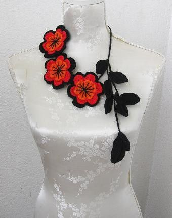 crochet flowers are lovely but I love the material covered mannequin !!!