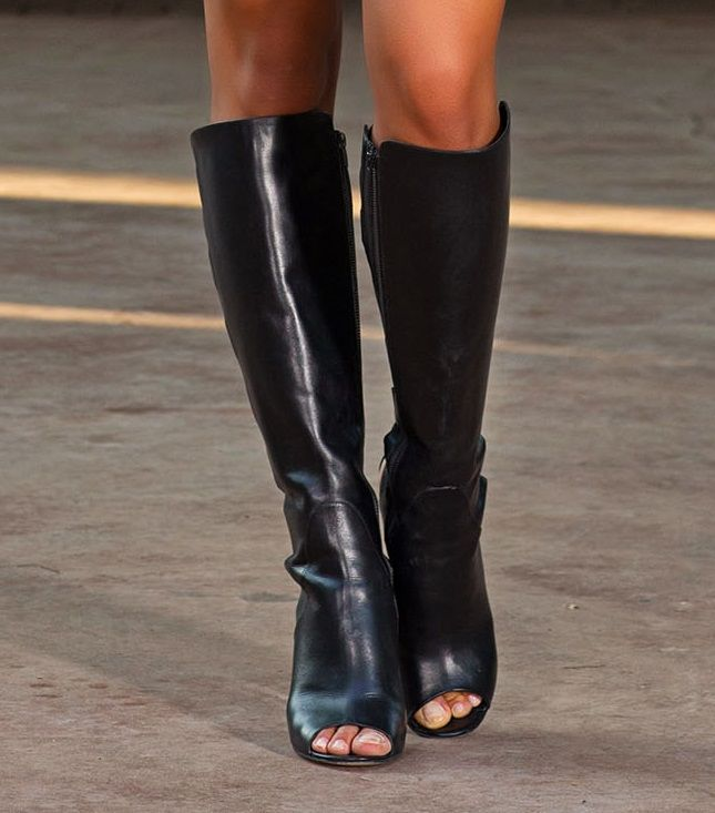 Black knee length boots add an edgy gothic appearance to any outfit. Opt for skyscraper heels to design the ultimate show stopping glamour and mood so desired by this trend.