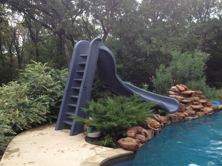 Curved Water Slide Beside Rock Waterfall This Is A Turbo