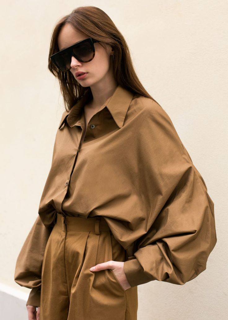 """#newarrivals #balloonsleeves #brown #cape #thefrankieshop #frankienyc #frankiegirl  Button Front Shirt w/Batwing Sleeves.Cape Silhouette Oversized Fit 100% Cotton 28"""" Length, Approx 28""""Width Dry Clean Imported"""