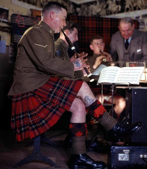 Unknown fella, but isn't he too fantastic? A tattooed, kilted, pipe-playing, WWII Scottish soldier, pictured here at The Army School of Piping in Edinburgh, Scotland, 1944.