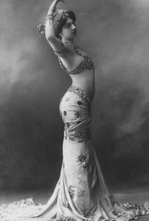 Mata Hari: 1876-1917; Mata Hari, was a Dutch exotic dancer, courtesan, and accused spy who was executed by firing squad in France under charges of espionage for Germany during World War I. Mata Hari's name has since become synonymous with espionage, although it remains by no means clear that she was guilty of the spying for which she charged.