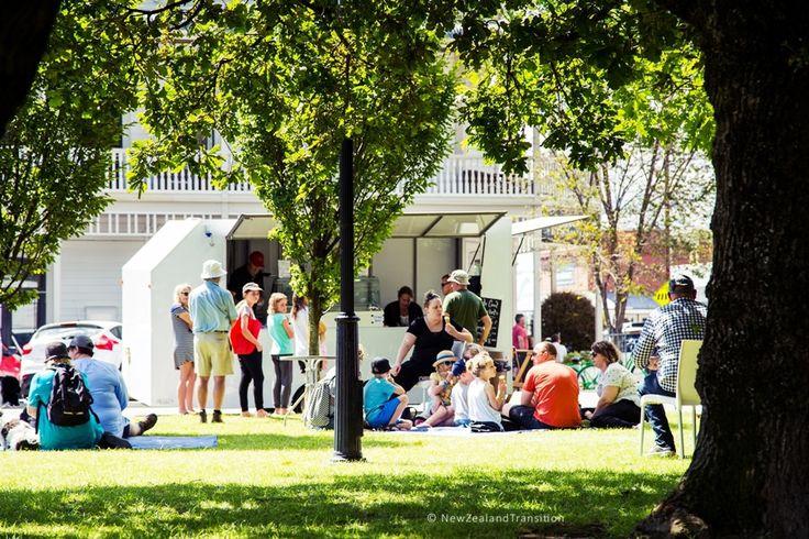 people sitting on lawn enjoying a hot summer day