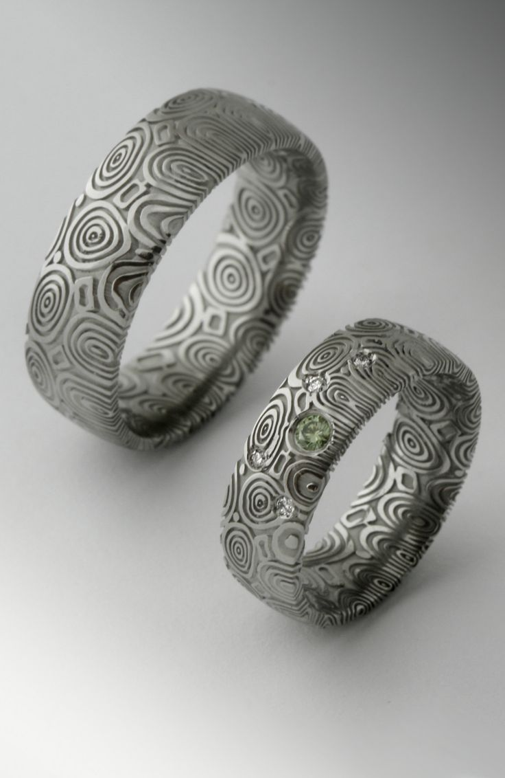 damasteel wedding ring with green and white diamonds
