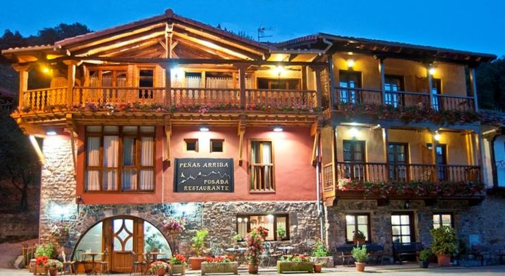 Posada Peñas Arriba Lon This typical mountain lodge is set in the foothills of the Picos de Europa mountains, in Cantabria's Camaleño Valley.  The Posada Peñas Arriba is built in a traditional style from stone and wood, and is located in the village of Lon.