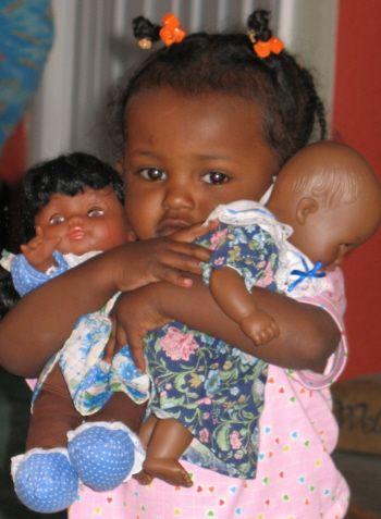 Google Image Result for http://www.blackloveandmarriage.com/wp-content/uploads/2011/05/Black-child-holding-Black-Dolls.jpg