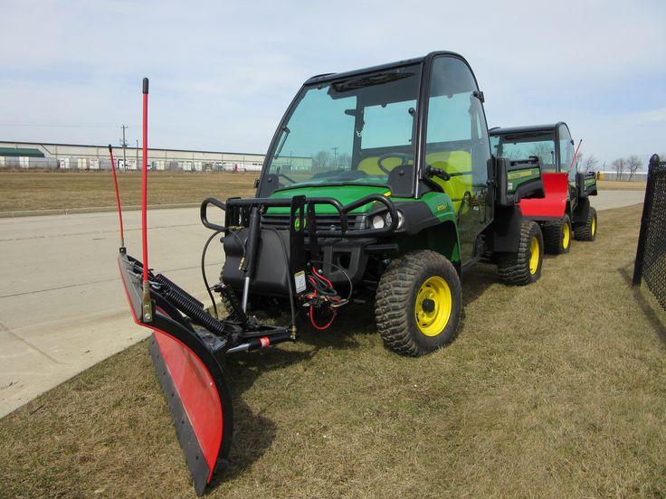 John Deere Gator 855D with red Boss plow