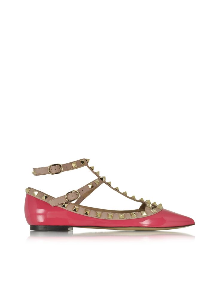 Rockstud Deep Fuchsia & Poudre Patent Leather Ballerina Shoe crafted in glossy patent leather, has a chic colorblock design that will rock your days or have you dancing through the night. Featuring platinum signature pyramid stud detail, T strap-Mary Jane hybrid ankle strap buckle, pointed toe and leather sole. Signature dust bag and box included. Made in Italy.