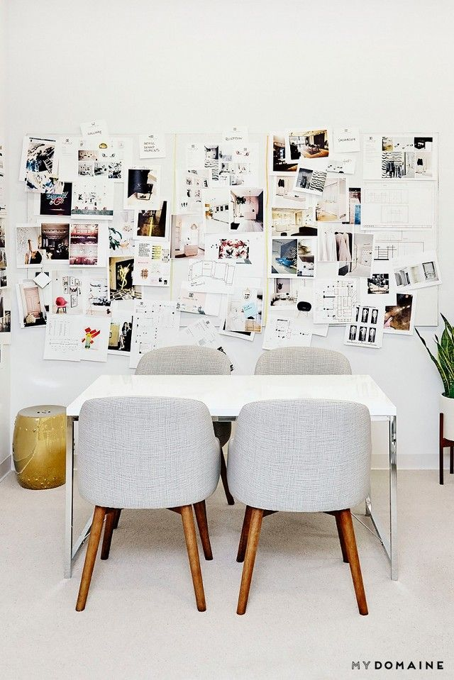 bright and modern office space with a large inspiration board a modern white table and bright modern office space