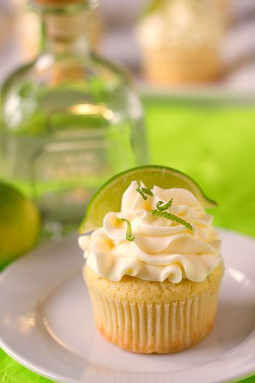 "Margarita cupcakes with Tequila-lime frosting. ""If you like margaritas...you will fall in love with these."""