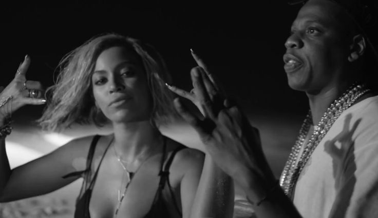 "From Beyonce's Drunk in love video- "" Here's the 'money-shot' of the video where they both incorporate the hand gestures of the Illuminati with Beyonce doing the horns of Moloch (aka Mano Cornuto) and Jay-Z doing the '666′ hand gesture"""