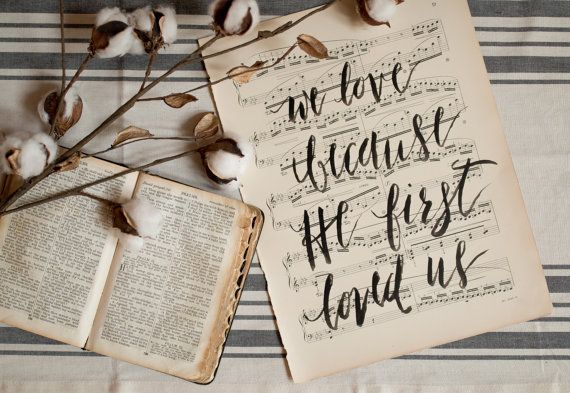 Lovely hand lettered print on antique 108 year old Chopin sheet music. Reads We love because He first loved us from 1 John 4:19.  Perfect as a gift for