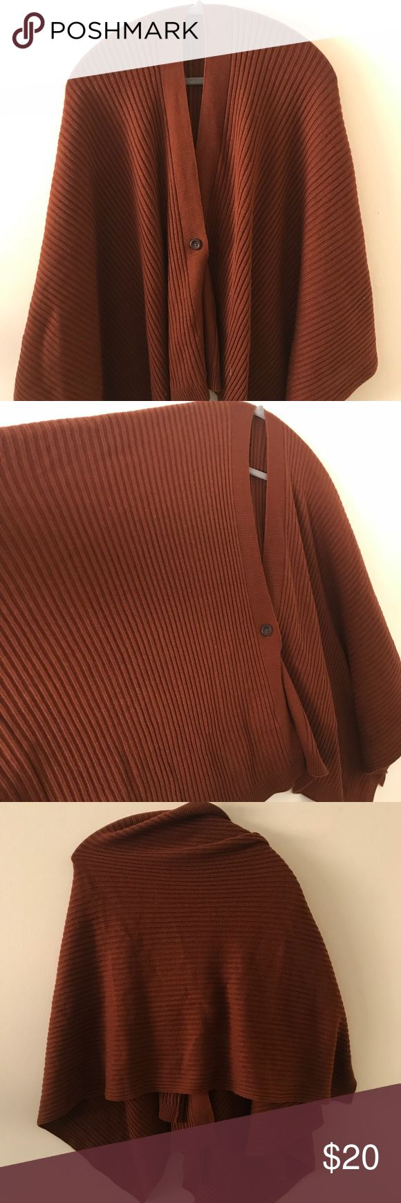 Uniqlo Cape This rust-colored cape can be worn as outerwear or on its own as a sweater. It can also be draped like an oversized scarf. Uniqlo Sweaters