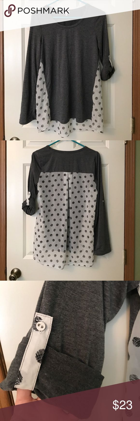 Mixed media polka dot print top - EUC Pixley brand top from Stitch Fix. This mixed media too has a soft grey knit on the front, and a super cute sketched polka dot ultra light poly in the back. The polka dot fabric is sheer. Features roll tab sleeves that can be worn full length, or rolled up and secured with a polka dot print tab and matching button. Super cute, and a little sexy with that sheer back. Great with a strappy or lace bralette to show off. Pixley Tops Blouses