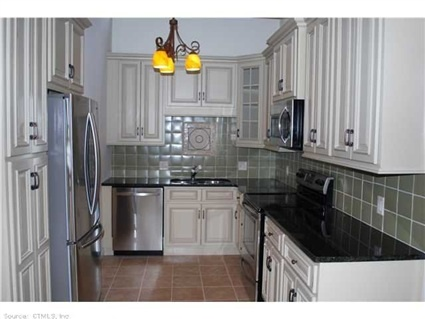 942 Heritage Vlg #942 A, Southbury, CT 06488 — Price adjustment! Completely new and remodeled throughout! 1398 sq. foot unit with the following: new kitchen with granite, new 6 panel doors inc. hardware, newly remodeled bathrooms, vanities & granite, all popcorn ceiling removed, new water heater, new A/C, newly installed Mannington Floors, tiled kitchen & baths, new w/w carpet in BR's. This unit is so beautiful! Plus easy access, lots of parking, short walk from parking