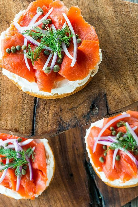 Savory breakfast, coming right up. This brined salmon, cold smoked and sliced thin, rests on a bagel and schmear, garnished with capers, red onion, tomatoes, and dill.
