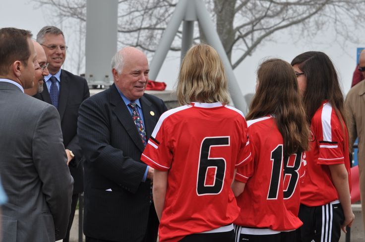 Terry MacRae with St. Catharines Jets Girls Under 15 Soccer team after the Ribbon Cutting Ceremony