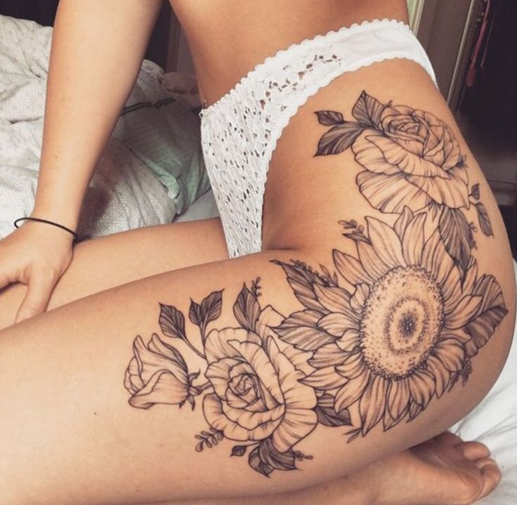 Killer floral piece that connects from the hip down to the outer thigh-- totally inspiring my tattoo placement.