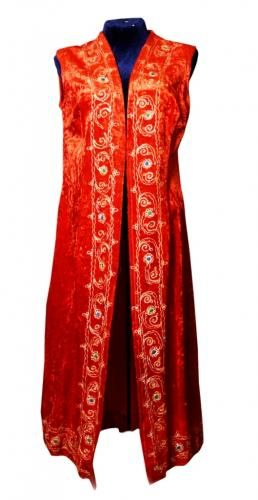 """Red dressing gown National clothes To your attention we offer the Uzbek national women's outer clothing """"A red dressing gown - a sleeveless jacket"""". It is small handwork, a basis material – duxoba (baxmal), and a material of a string of an embroidery – natural silk and a thread from cotton."""