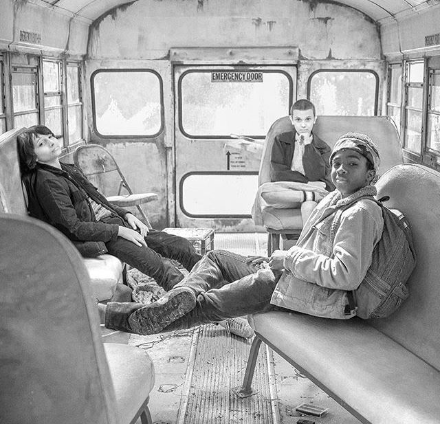 Finn Wolfhard, Millie Bobby Brown, and Caleb McLaughlin behind the scenes of Stranger Things season 1